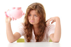 Woman and piggy bank Stock Images