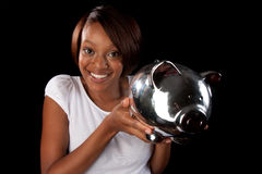 Woman with piggy bank Royalty Free Stock Photography
