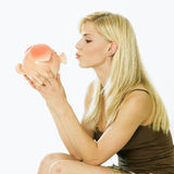 Woman with a piggy bank Stock Photo