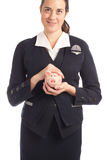 Woman and piggy bank Stock Image