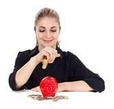 Woman and piggy bank Royalty Free Stock Photos
