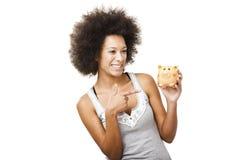 Woman with a piggy bank Stock Photos