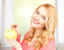 Woman with piggy bank and cash money Royalty Free Stock Images