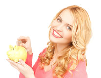Woman with piggy bank and cash money Royalty Free Stock Image