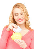 Woman with piggy bank and cash money Royalty Free Stock Photos