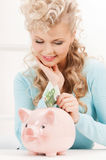Woman with piggy bank and cash money Stock Photos