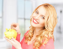Woman with piggy bank and cash money Royalty Free Stock Photo