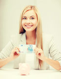 Woman with piggy bank and cash money Stock Photo