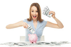 Woman with piggy bank and dollar bills Royalty Free Stock Photography