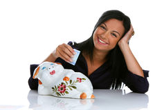 Woman with piggy bank and euro bank notes. Young woman with piggy bank and euro bank notes Royalty Free Stock Image