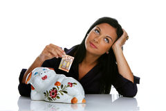 Woman with piggy bank and euro bank notes Stock Images