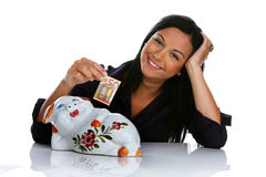 Woman with piggy bank and euro bank notes Stock Photos