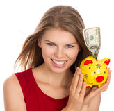 Woman with piggy bank Royalty Free Stock Photos