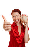 Woman with piggy bank holding Stock Image