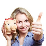 Woman with piggy bank holding Royalty Free Stock Images