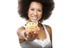 Woman with a piggy bank Stock Image