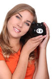 Woman with a piggy bank Royalty Free Stock Images