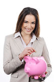 Woman with piggy bank and money. Picture of lovely woman with piggy bank and money Stock Images