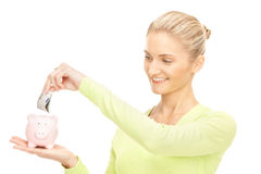 Woman with piggy bank and money Stock Image