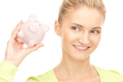 Woman with piggy bank Royalty Free Stock Image