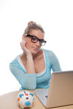 Woman with a piggy bank researching on her laptop Stock Images