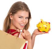 Woman with piggy bank Stock Photography