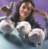 Woman with piggy banks stock photos