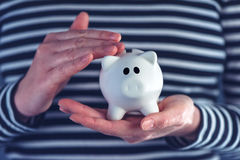 Woman with piggy coin bank. Home budget, finance and savings concept Stock Photo