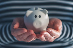 Woman with piggy coin bank. Home budget, finance and savings concept Royalty Free Stock Image