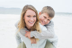 Woman piggybacking her son at beach Royalty Free Stock Photo