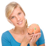 Woman with piggybank Stock Image
