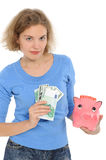 Woman with a piggybank Royalty Free Stock Photography