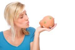 Woman with piggybank Stock Images
