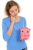 Woman with a piggybank Stock Images
