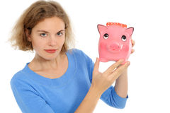 Woman with a piggybank Royalty Free Stock Images