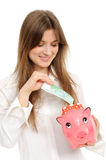 Woman with a piggybank Royalty Free Stock Photo