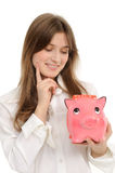 Woman with a piggybank Royalty Free Stock Photos