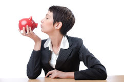 Woman and piggybank. On white Royalty Free Stock Photo
