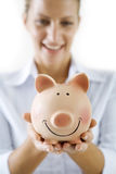 Woman and piggybank Royalty Free Stock Images