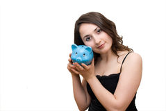 Woman with piggybank. A young attractive woman with blue piggy-bank Royalty Free Stock Photo