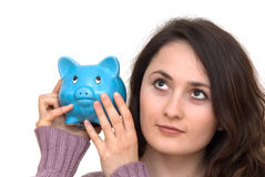 Woman with piggybank. A young attractive woman with blue piggy-bank Stock Images