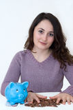 Woman with piggybank. A young attractive woman with blue piggy-bank Royalty Free Stock Photos