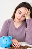 Woman with piggybank. A young attractive woman with blue piggy-bank Stock Photography
