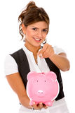 Woman with a piggybank Stock Photography