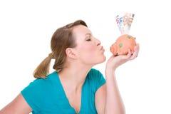Woman With Piggybank Stock Photos
