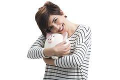 Woman with a piggybank Stock Photos