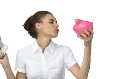 Woman with a piggybank and cash in her hands Royalty Free Stock Photography
