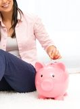 Woman with piggybank Royalty Free Stock Photo