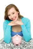 Woman with piggybank and dollar bills Royalty Free Stock Image