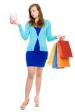 Woman with piggybank and shopping bags Royalty Free Stock Image